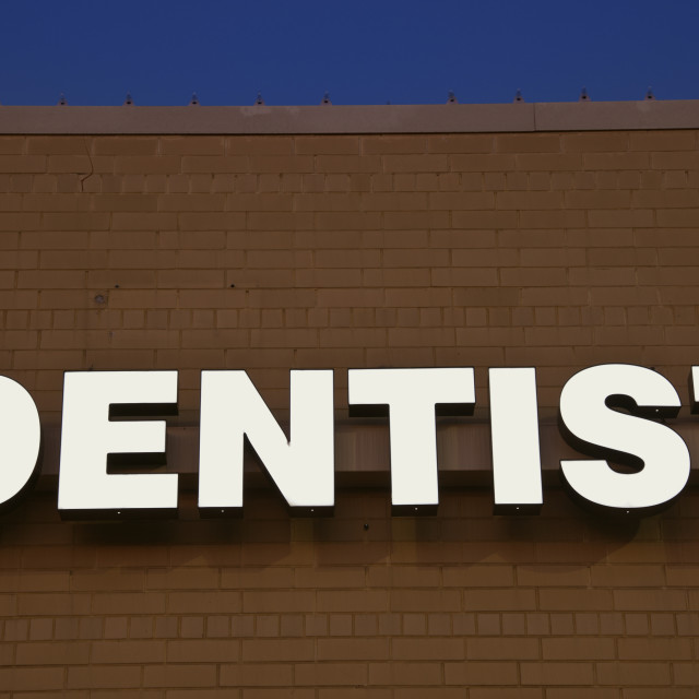 """Dentist sign on the brick wall"" stock image"