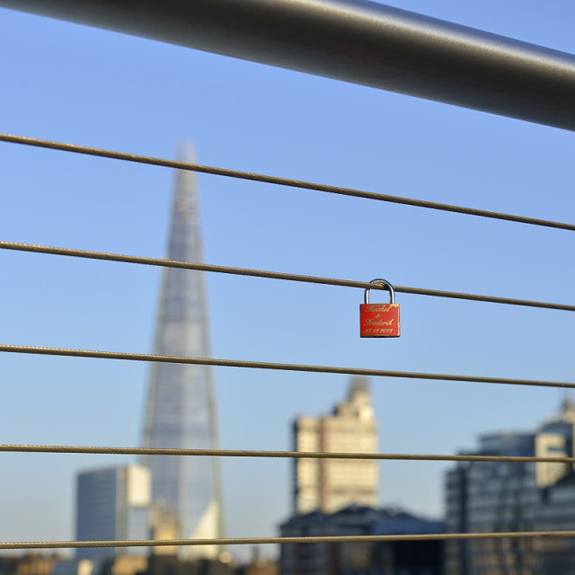 """""""Red padlock hanging on a fence"""" stock image"""