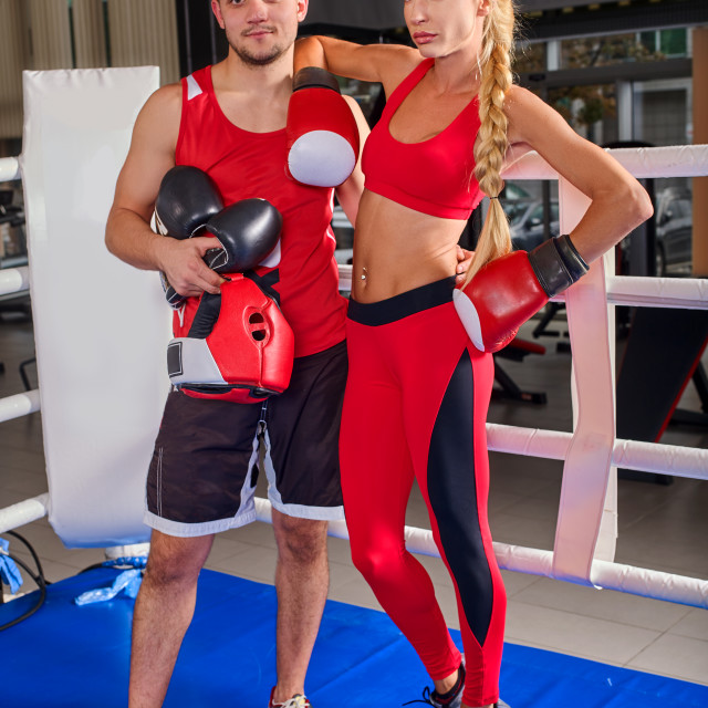 """Female boxer with your male coach after workout."" stock image"