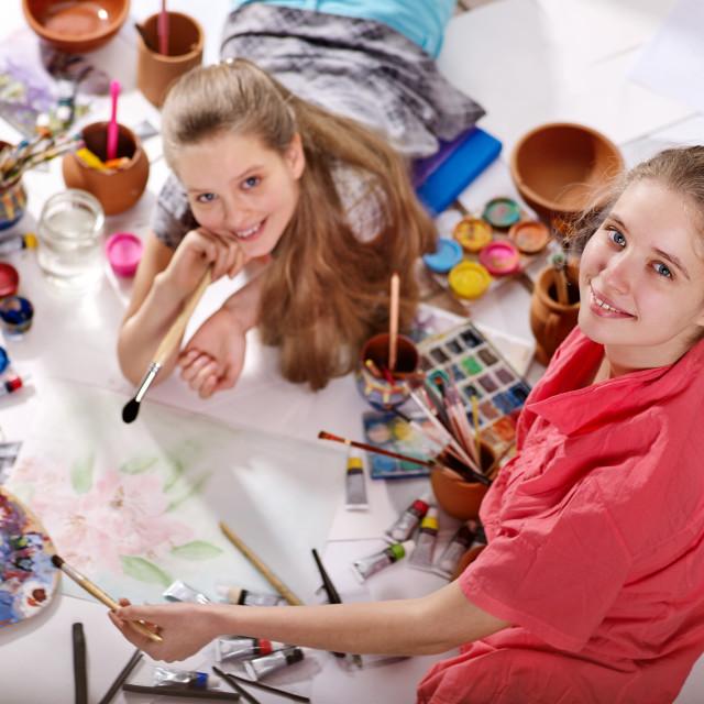 """""""Authentic artist children girl paints on floor. Top view."""" stock image"""