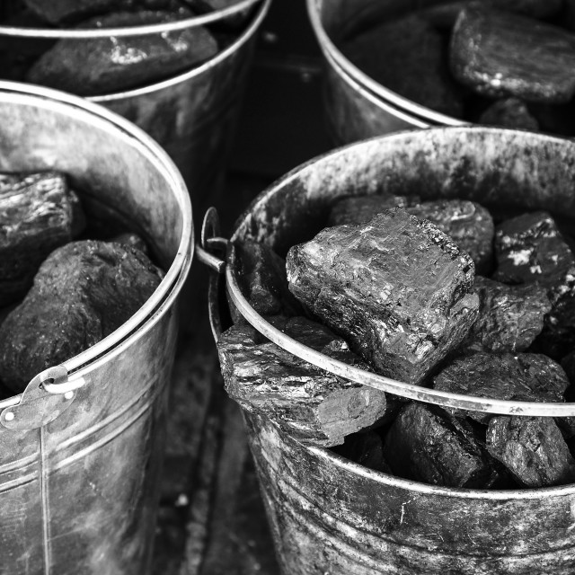 """Close up of metal buckets filled with coal"" stock image"