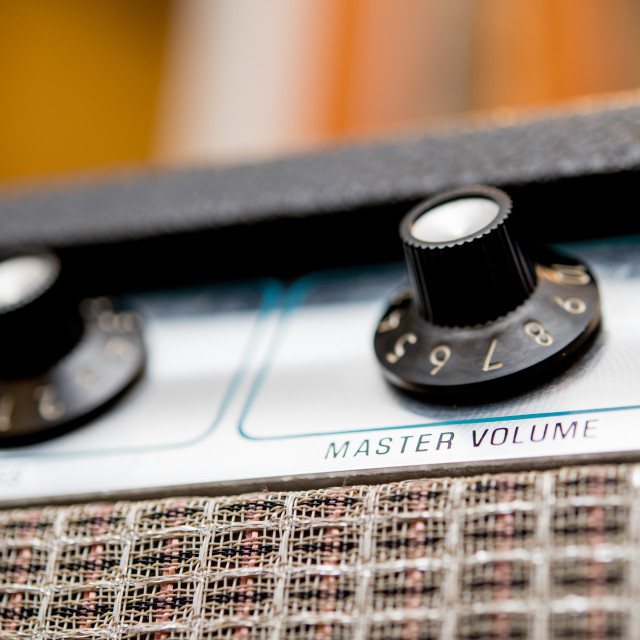 """Volume control concept, guitar amplifier knobs detail"" stock image"
