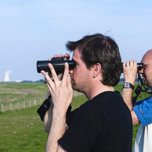 """Men with binoculars"" stock image"