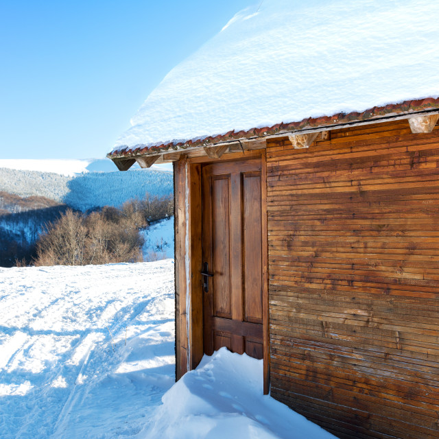 """log cabin covered with snow"" stock image"