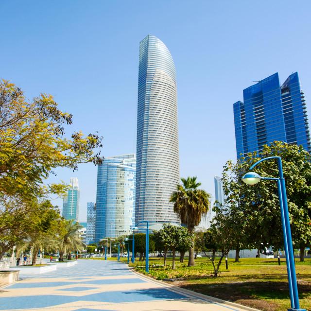 """Abu Dhabi Corniche walking area with landmark view of modern bui"" stock image"