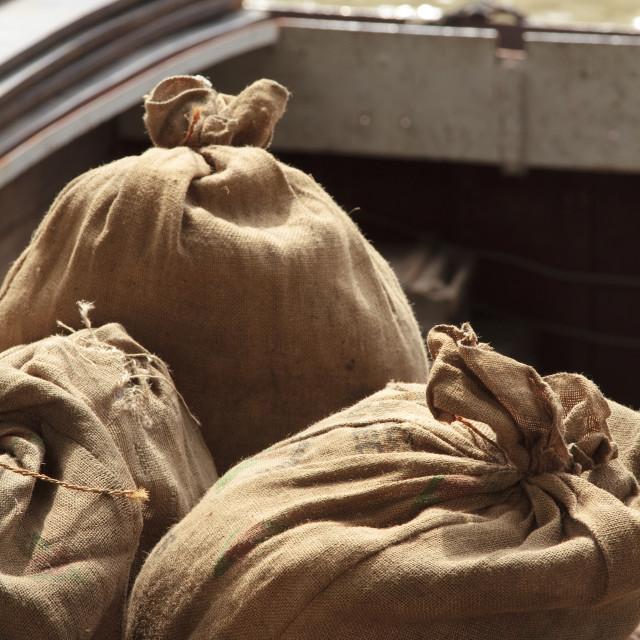 """Jute sacks waiting to be loaded"" stock image"