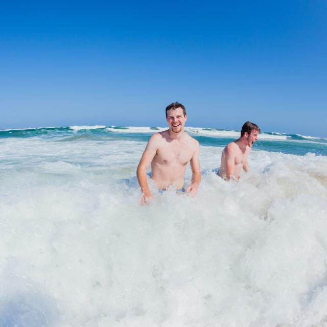 """Men Ocean Shorebreak Swim"" stock image"