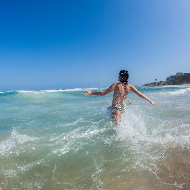 """Teenager Girl Ocean Shorebreak Swim"" stock image"