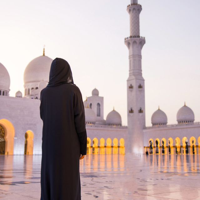 """Female tourist at Sheikh Zayed Grand Mosque"" stock image"