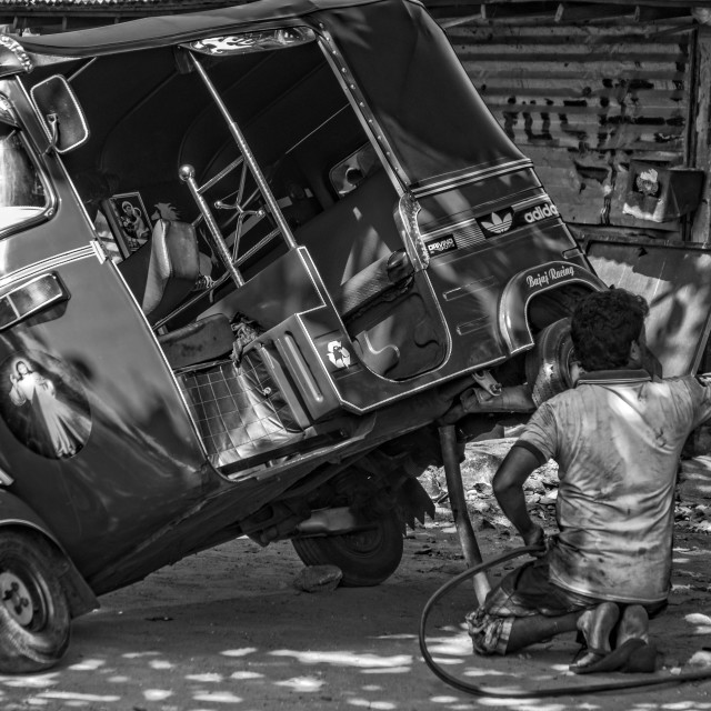 """Repair of a tuk-tuk"" stock image"