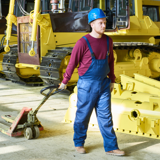 """""""Factory Worker Operating Pallet Jack"""" stock image"""