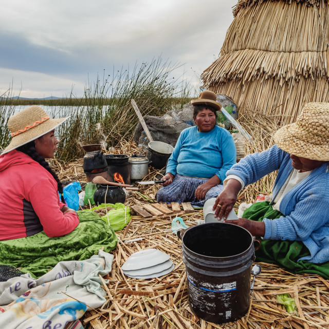 """Native Uro Family preparing a meal, Uros Floating Islands, Lake Titicaca,..."" stock image"