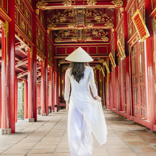 """A woman in a traditional Ao Dai dress and Non La conical hat in the Forbidden..."" stock image"