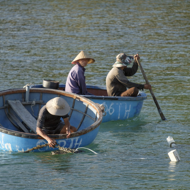 """""""Cham island fishermen in traditional coracle round basket fishing boats"""" stock image"""