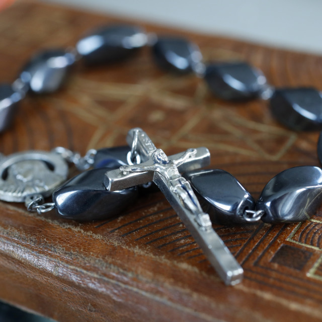 """""""Rosary beads on an old bible. Ho Chi Minh City. Vietnam."""" stock image"""