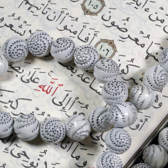 """""""Quran and Tasbih (prayer beads). Allah monogram in red."""" stock image"""