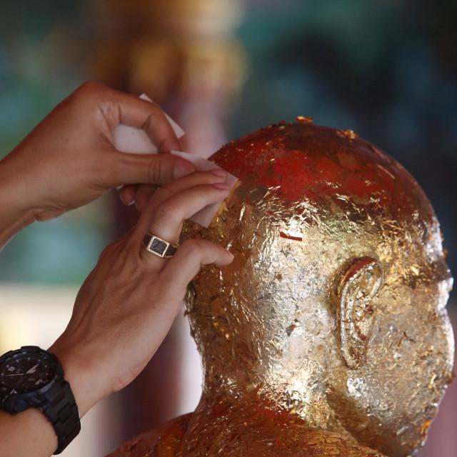 """Khao Pansa celebration at Wat Ampharam, Hua Hin. Faithful offering gold..."" stock image"