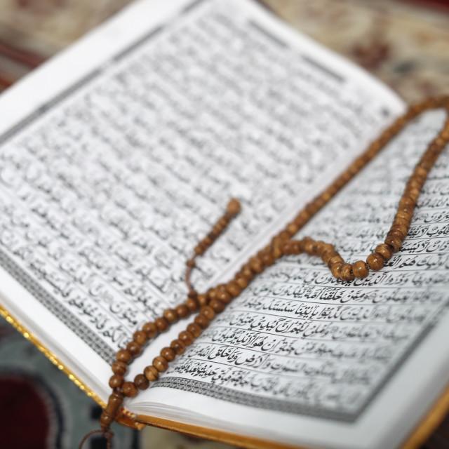 """Jamiul Islamiyah Mosque. Arabic Holy Quran or Koran with prayer beads (..."" stock image"