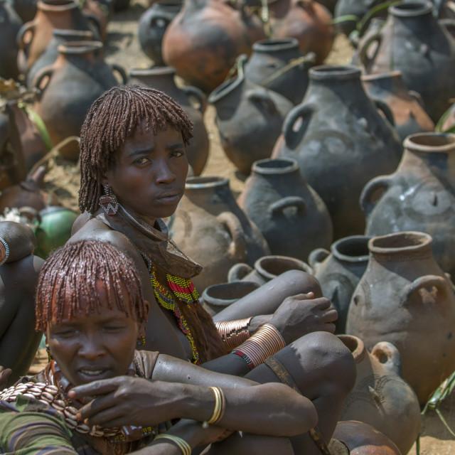 """Hamer Tribe Women Selling Potteries In Market, Dimeka, Omo Valley, Ethiopia"" stock image"