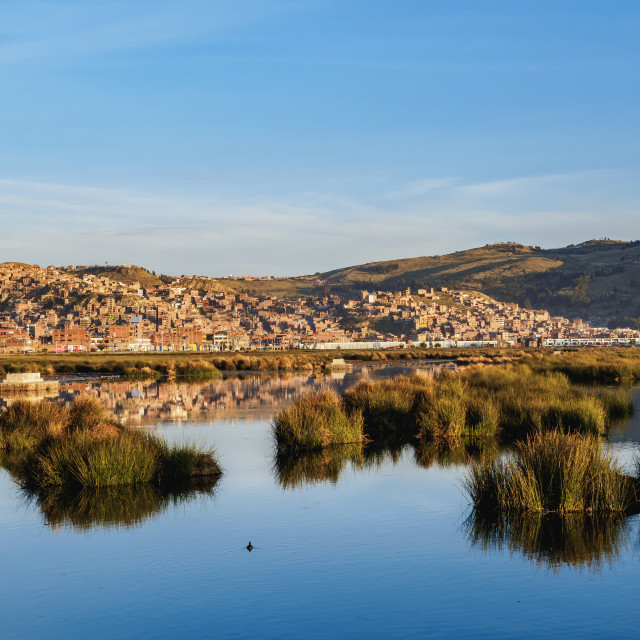 """Lake Titicaca and Cityscape of Puno at sunrise, Peru"" stock image"