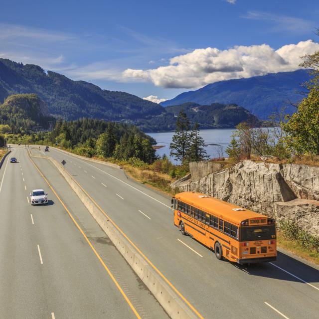 """Yellow school bus on The Sea to Sky Highway near Squamish, British Columbia,..."" stock image"