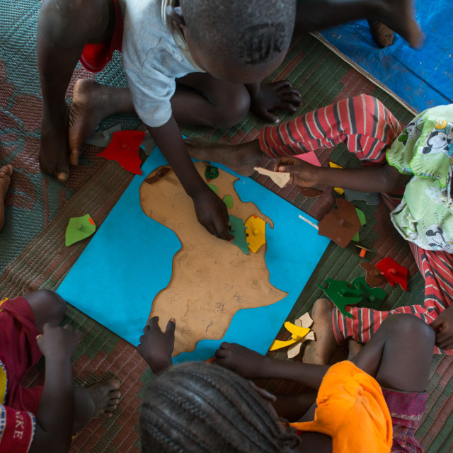 """Nyangatom and toposa tribe children at school, Omo valley, Kangate, Ethiopia"" stock image"