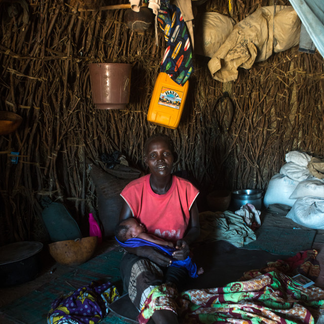 """""""Toposa mother with her new born baby in her hut, Omo valley, Kangate, Ethiopia"""" stock image"""