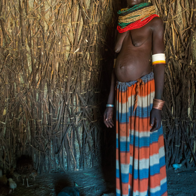 """""""Toposa tribe woman standing in her hut, Omo valley, Kangate, Ethiopia"""" stock image"""