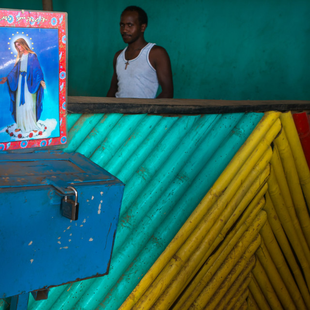 """""""Donation box with virgin maria poster on it in a bar, Omo valley, Kangate,..."""" stock image"""