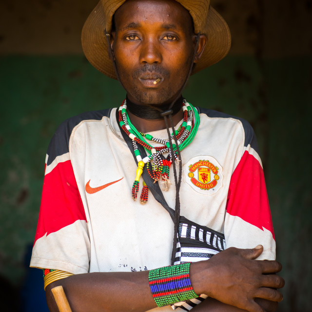 """Portrait of a hamer tribe man wearing a manchester united football shirt, Omo..."" stock image"