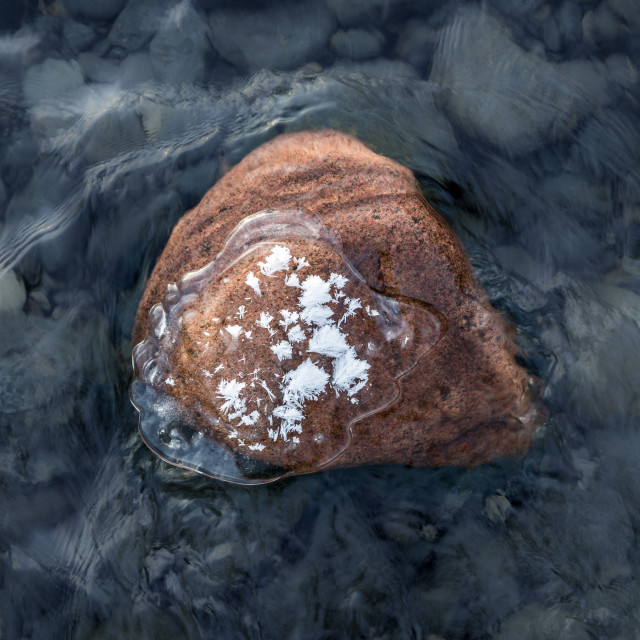 """""""Red rock in river"""" stock image"""