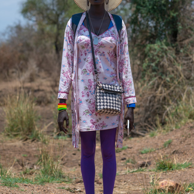 """""""Young mursi tribe woman dressed in western clothes to go in town, Omo valley,..."""" stock image"""