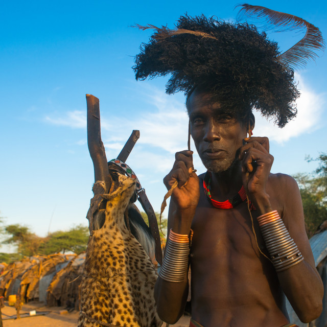 """""""Dassanech man dressing with a ostrich feathers headwear for dimi ceremony to..."""" stock image"""
