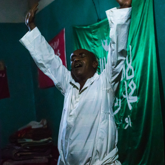 """Sufi man goes into a trance during a ceremony, Harari region, Harar, Ethiopia"" stock image"
