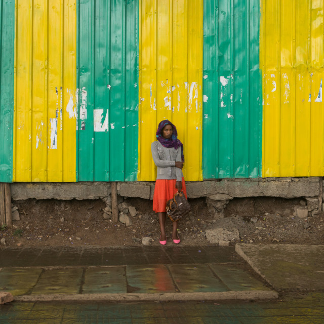 """Woman looking for shelter under the rain, Addis abeba region, Addis ababa,..."" stock image"