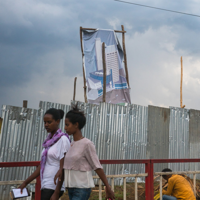 """Women passing in front a real estate billboard, Addis abeba region, Addis..."" stock image"