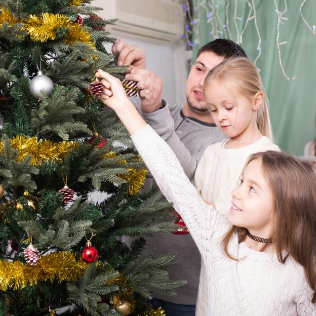 """people decorating Christmas tree"" stock image"