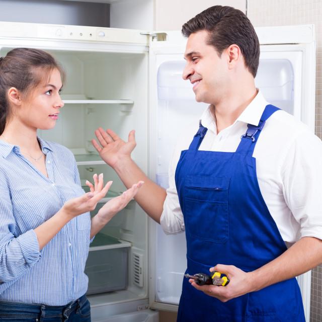 """woman complaining to handyman"" stock image"