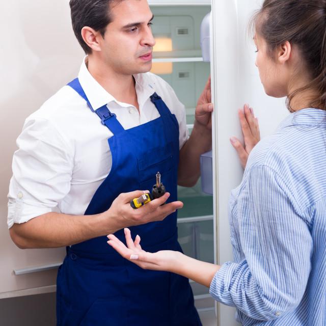 """woman complaining to handyman on problems"" stock image"