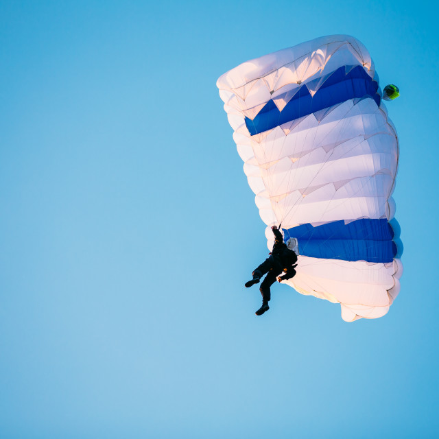 """""""Single Skydiver On Parachute In Blue Clear Sky. Active Lifestyle"""" stock image"""