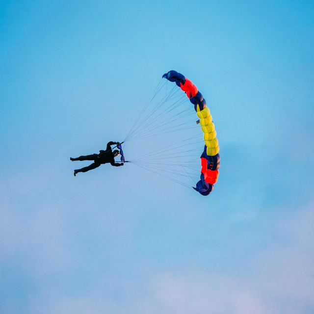 """""""Skydiver On Colorful Parachute In Sunny Sky"""" stock image"""