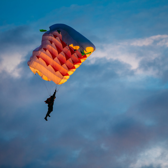 """""""Skydiver On Colorful Parachute In Sky"""" stock image"""