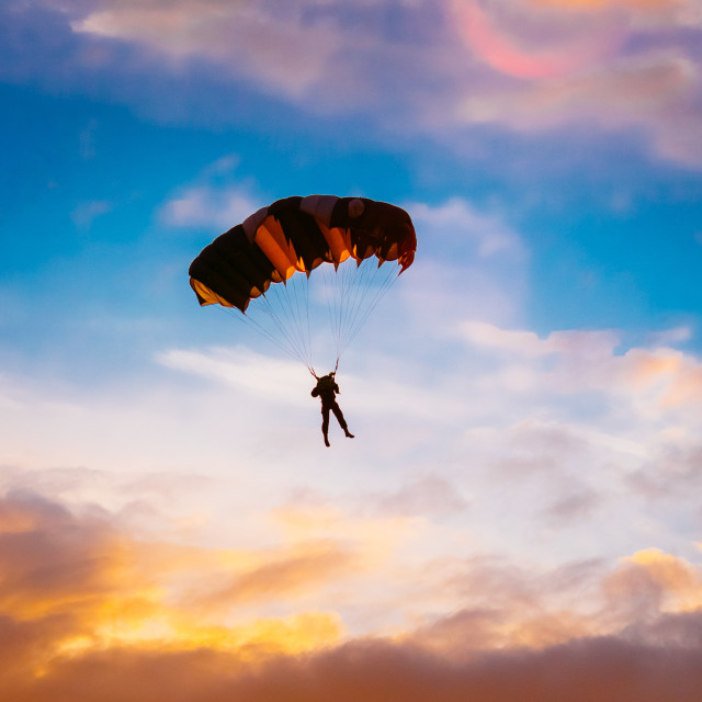 """""""Skydiver On Colorful Parachute In Sunny Sunset Sunrise Sky"""" stock image"""