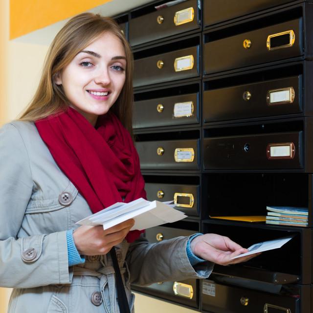 """Girl checking correspondence at lobby"" stock image"