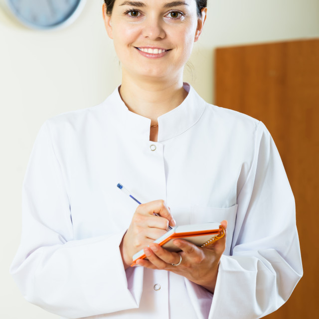 """""""Smiling female physician indoors"""" stock image"""