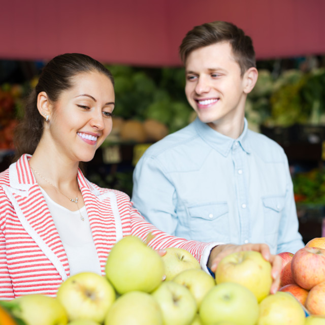 """Couple choosing veggies and fruits"" stock image"