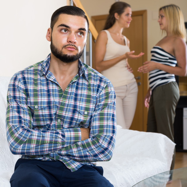 """person keeping silence turned away from friends"" stock image"