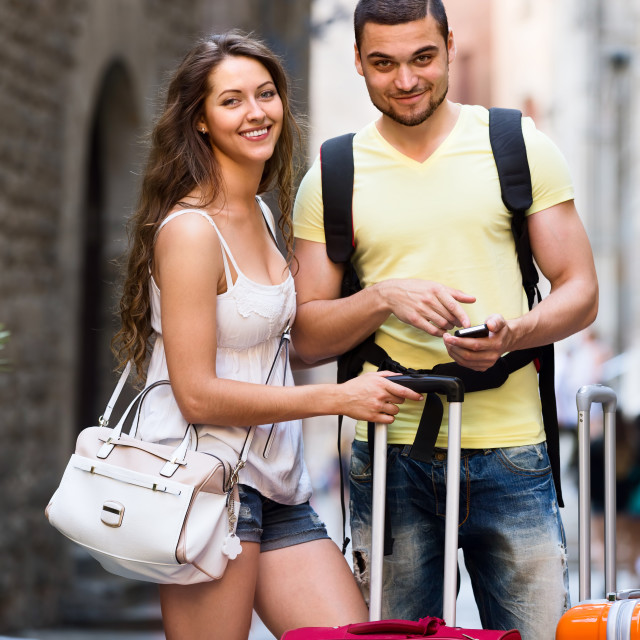 """young travellers finding path with phone"" stock image"
