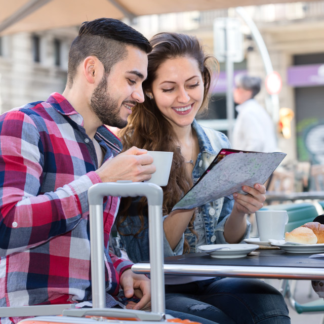 """Couple resting in cafe during trip"" stock image"