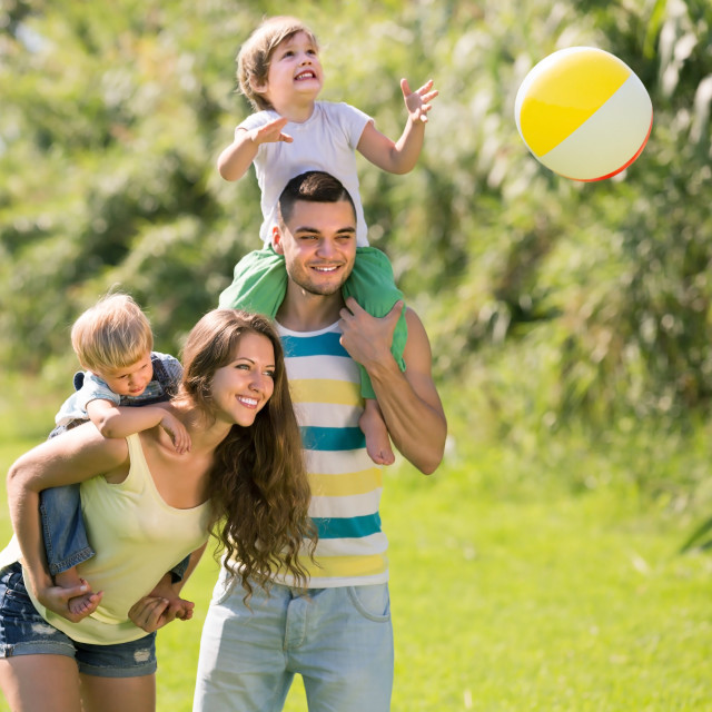 """Parents with little daughters outdoor"" stock image"